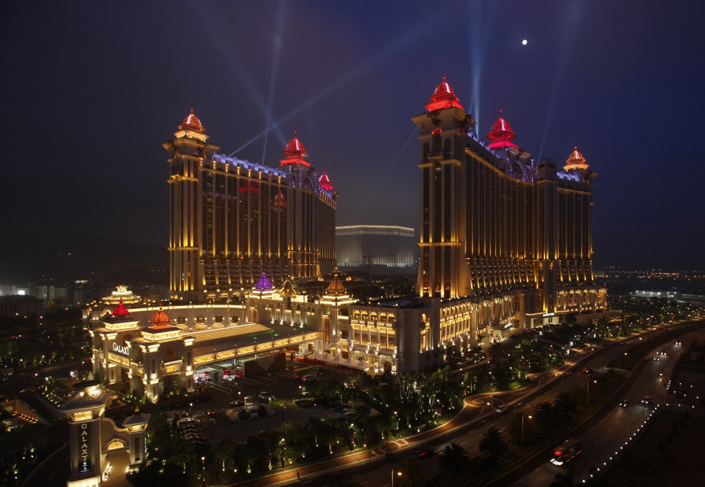 Galaxy Macau, the latest resort in Macau built by Galaxy Entertainment Group, is lit up in the evening after it opened for business May 15, 2011. Some of the world's biggest casino operators are betting that Chinese moms and pops who like to gamble and also want to shop and dine will turbocharge growth over the next few years at Macau, the world's biggest gambling destination. Macau, located on the Southern tip of China and an hour away by ferry from Hong Kong, has so far relied heavily on China's young and wealthy for casino revenues, which totaled about $24 billion in 2010 -- well above what Las Vegas earned.    REUTERS/Bobby Yip   (CHINA - Tags: BUSINESS TRAVEL ENTERTAINMENT) - RTR2MFZ3